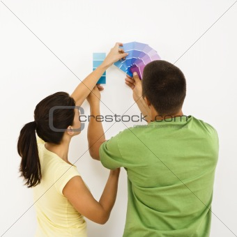Couple choosing home color.