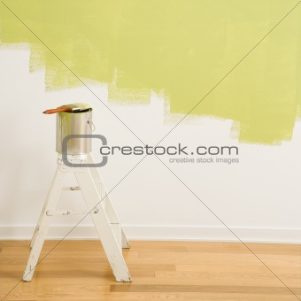Paint can on ladder.