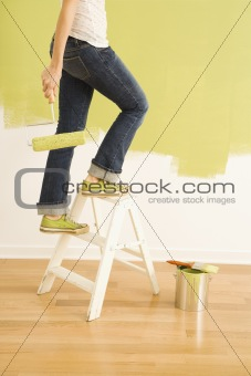 Female painter on ladder.
