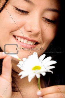 happy girl with a white flower