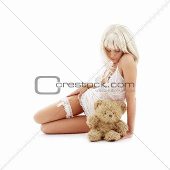 sad blond with teddy bear