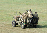 Soldiers in a small vehicle