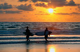 surfers at red sunset