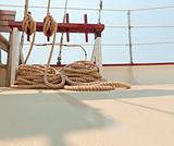 Coiled rope rigging on a sailboat deck.