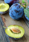ripe juicy blue plum on a wooden table