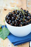 black currants ripe and natural on a wooden table