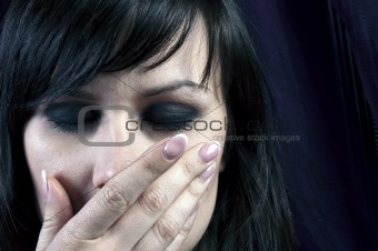 Young girl covering her mouth with her hand in black and white