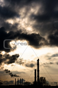 Silhouette of a power plant against evening sky