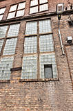 Angle shot of an abandoned industrial building with brick wall