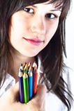 Student girl with colored pencils