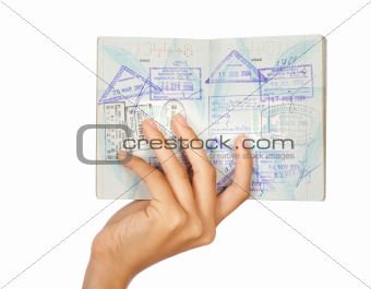 Hand showing passport, close-up shot