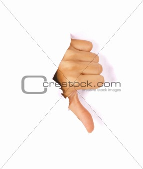 Hand making thumbs down sign breaking through a thin wall or paper