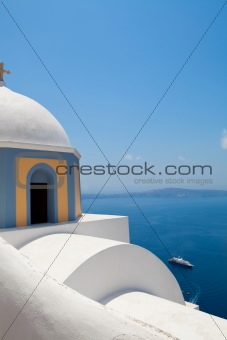 Old church dome and view of mediterranean sea in Santorini