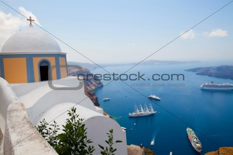 Old church dome and view of boats in Santorini