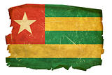 Togo Flag old, isolated on white background.