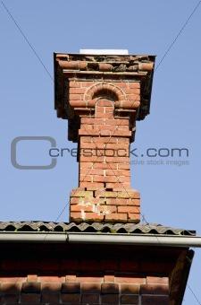 Antique red brick chimney.