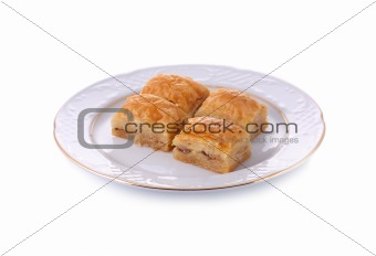 Turkish traditional dessert Baklava served in porcelain dish isolated on white with clipping path
