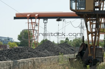 Crane and piles of coal