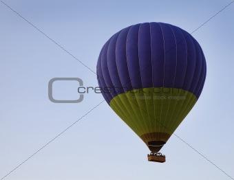 Green deep blue balloon sky blue background