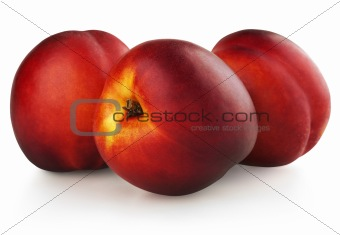 Three nectarines isolated on white