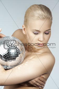 blond with creative make up an shining ball