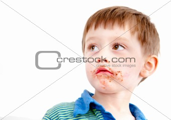 Toddler eating chocolate