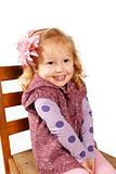 Pretty little girl sitting on a chair