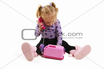 Little girl playing with phone
