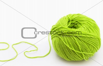 Threads for knitting on spokes of green  on white background