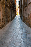 narrow medieval stone street in old Palermo, Sicily