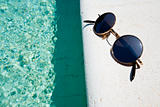 black round sun glasses on pool board