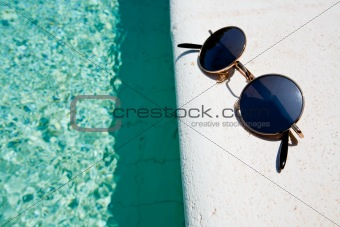 black round sun glasses on pool board