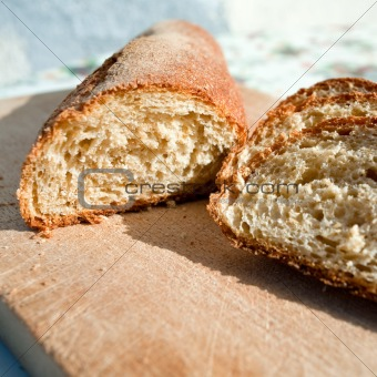 sliced homemade bread on wooden board closeup