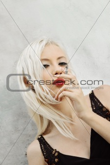 Portrait of smoking beautiful young woman