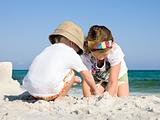 Kids Building Sandcastle on a Beach