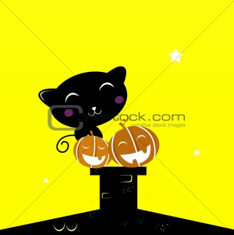 Black Halloween cat silhouette sitting on the roof during Night