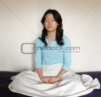 Asian woman in meditation