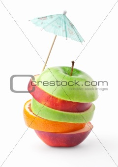 Layers of apples and oranges under umbrella