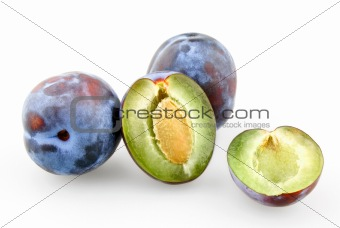 Black plums and sliced plum with stone