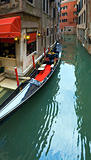Venetian view with parked gondola