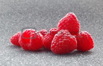 Closeup image of Fresh Raspberries on the Dark Background