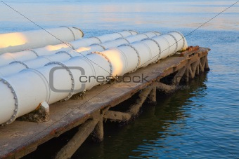 A closeup of large sewage pipes