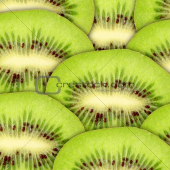 Abstract green background with raw kiwi slices