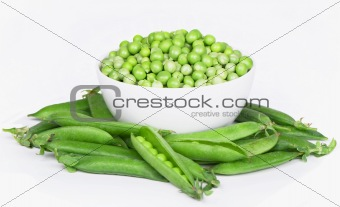 Bowl with green peas the isolated on white background