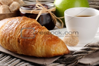 Coffee, french croissant and jam