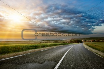 Coastal road with sunset