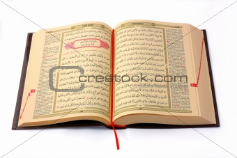 The Holy Koran opened and isolated on white background