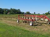 Hay Rake Sitting in a Field of Just Raked Hay