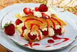 Milfeis with strawberries and berry sauce.