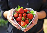 strawberry in heart shape bowl